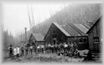 Group of workers in front of mine buildings, wpH109